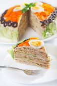 picture of iceberg  - Salty cake made from pancakes tuna fish eggs carrots olives and iceberg salad - JPG