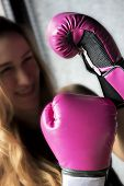 stock photo of boxing  - Boxing Woman Closeup to Pink Boxing Gloves soft focus - JPG