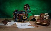 stock photo of steampunk  - Photo camera and drawing on a wooden table - JPG