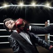 stock photo of boxing ring  - Two businessman with boxing gloves in the ring fighting with each other - JPG