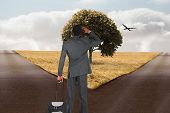 foto of crossroads  - Young businessman standing with suitcase against crossroads - JPG