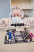 stock photo of cpu  - Engineer working on broken cpu in the laboratory - JPG