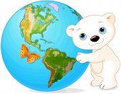 stock photo of earth  - Polar Bear hugs the Earth at Earth Day - JPG
