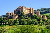 stock photo of chateau  - View of the hilltop castle of Chateau de Berze in Burgundy France - JPG