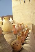 stock photo of pottery  - Rows of earthenware Pottery in Nizwa - JPG