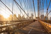 picture of brooklyn bridge  - Couple walking on pedestrian path across Brooklyn bridge - JPG