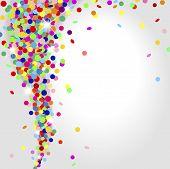 foto of confetti  - whirlwind of multicolored confetti on a light background - JPG