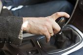 image of levers  - Car interior elegant man hand on a gear shift lever - JPG