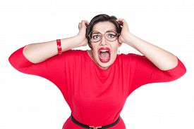 stock photo of screaming  - Scared screaming beautiful plus size woman in red dress isolated on white background - JPG