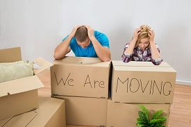 foto of text-box  - Frustrated Young Couple With Moving Boxes At Home - JPG