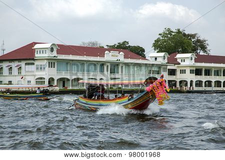 Excursion and pleasure boats sail on Chao Phraya river in Bangkok