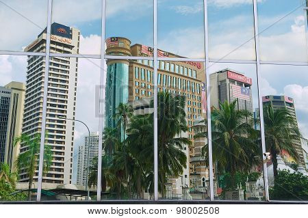 Reflection of the office buildings in the modern building windows in Kuala Lumpur, Malaysia.