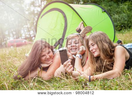 Group Of Friends Taking A Picture On Their Camping Holiday