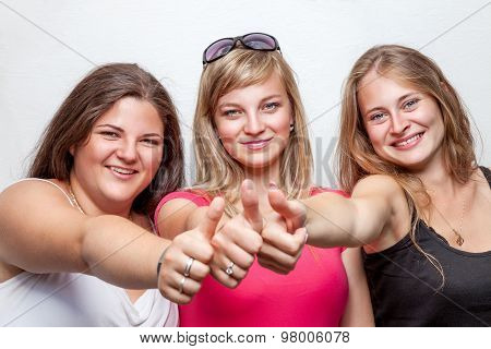Group Of Happy Friends Giving The Thumbs Up