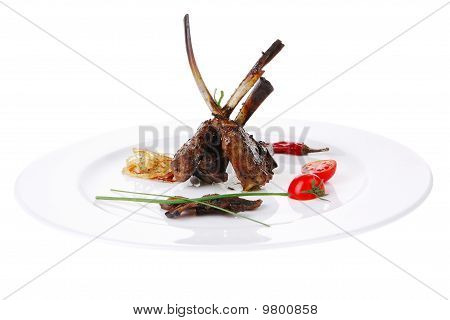 Grilled Ribs Served Over Big White Plate
