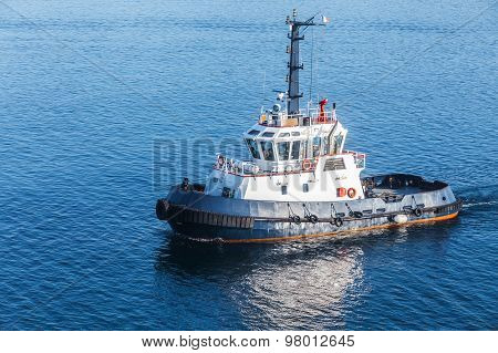 Small Tug Boat With White Superstructure