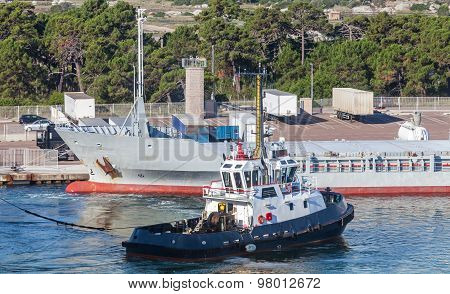 Small Tug Boat Works In Port
