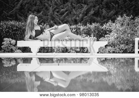 Bikini Asia Woman On Sunbath Longue By The Pool