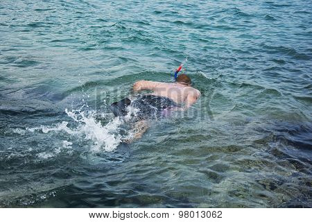 Man Snorkeling In Clean Waters