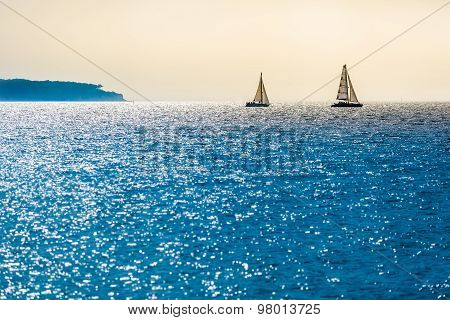 Two Sailboats at the Horizon