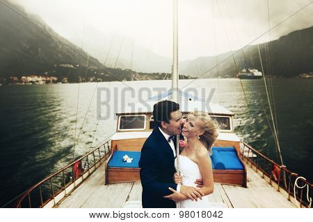 Stylish Young Bride And Groom Huging And Smiling On Board The Yacht Montenegro On Board The Yacht Mo