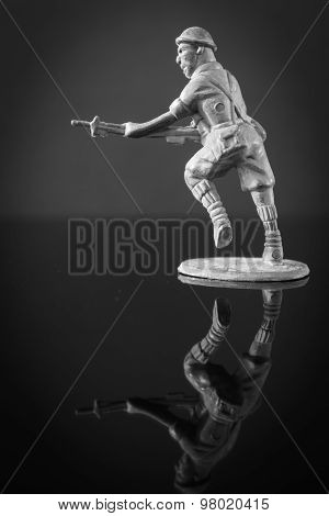 Mini toy soldier on black background