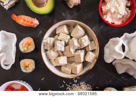 Tofu Cheese And Sushi On A Dark Background