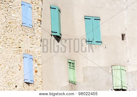 Facade With Closed  Shutters In Blue, Turquoise And Green, South Europe, France