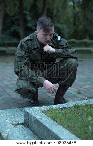 Young Caucasian Soldier Visiting Cemetery