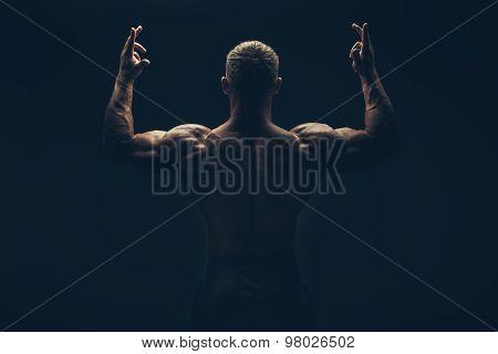 Back of a muscular man naked, studio shot
