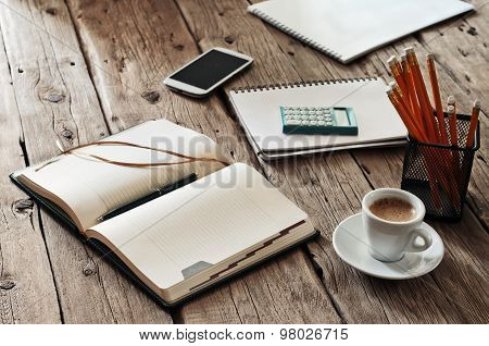 Blank Notebook On Wooden Table With A Cup Of Black Coffee