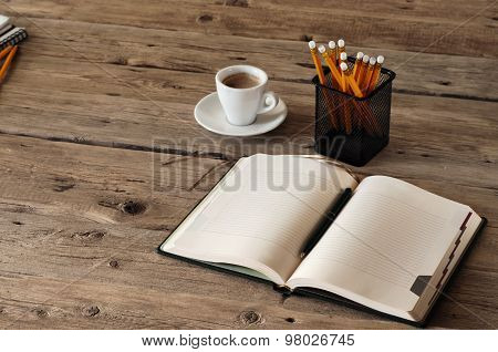 Blank Notebook On Wooden Table With