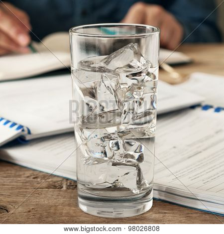 Glass Of Water On A Wooden Office Desk