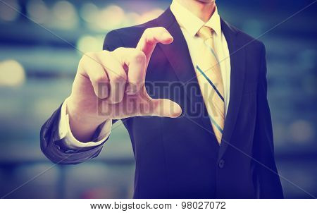 Business Man Holding Something Between His Fingers