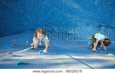 Little girl in  rock climbing gym