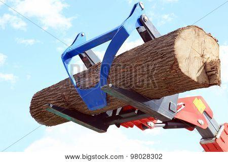 Forklift Unloads Log