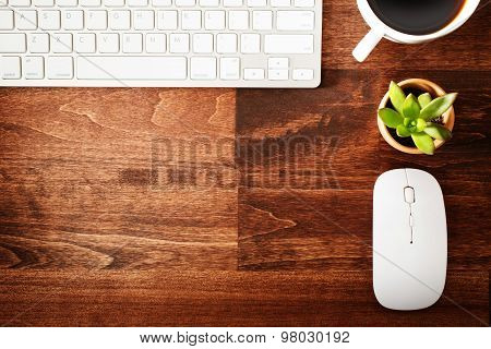 Neat Workstation On A Wooden Desk