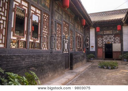 red lanterns and traditional chinese courtard houses