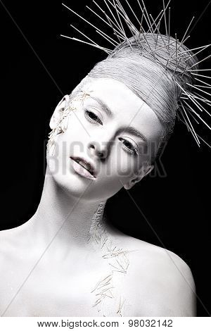 Art fashion girl with white skin and unusual hairstyle. Creative art beauty.