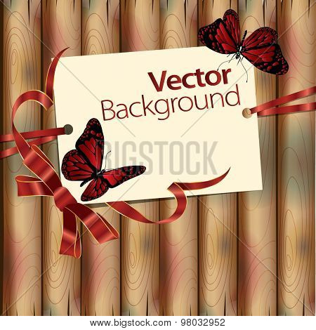 Wooden background with ribbon, butterflies and invitation card