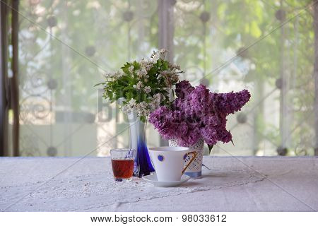 Still-life With Tea, Wine And A Lilac Bouquet