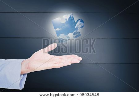 Handsome businessman gesturing with hands against blue sky Handsome businessman gesturing with hands on a white background