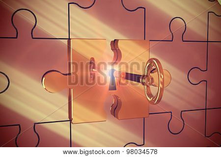Key unlocking jigsaw