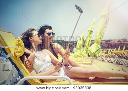 Two girls at the beach doing a selfie