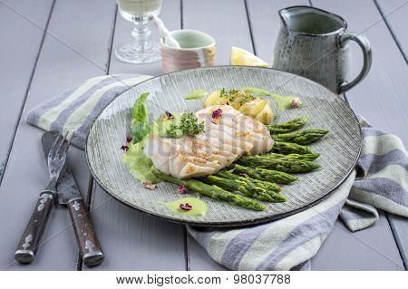 cod fish fillet with green asparagus