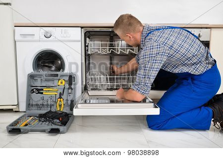 Man Repairing Dishwasher