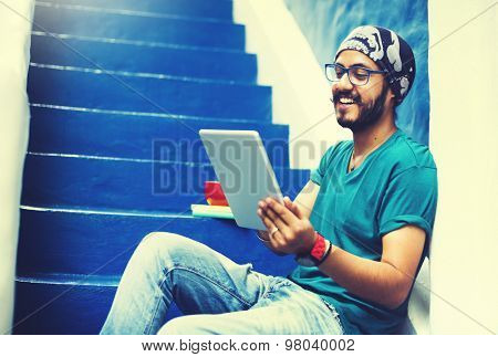 Sikh Guy Browsing Tablet Stair Case Concept
