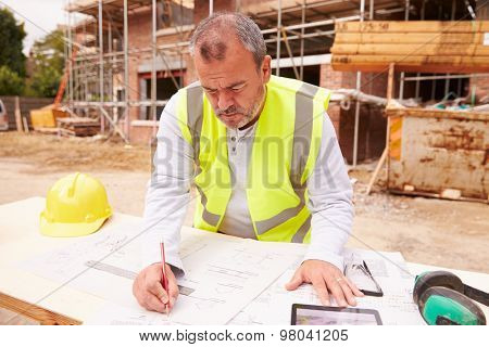 Construction Worker Using Digital Tablet On Building Site