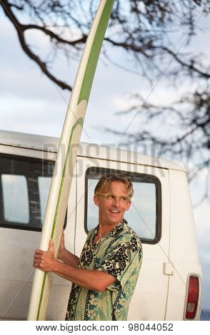 One Man Holding Surfboard