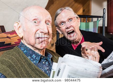 Old Mad Couple With Newspaper